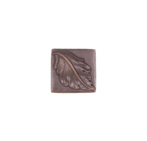 small single leaf on solid bronze tile