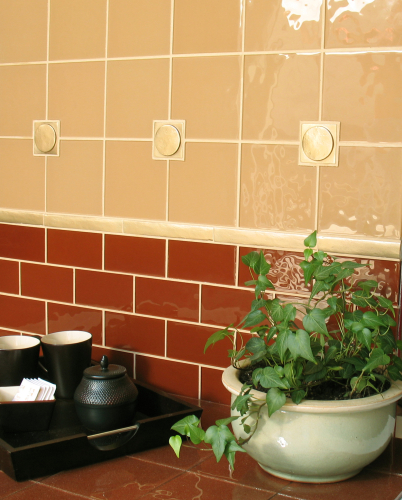 Bronze tile backsplash by Saint-Gaudens Tile
